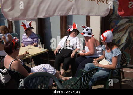 Hen party group. Lady football fans. Southend, Essex.  England  Drinking outside a pub. Homer Sykes - Stock Photo