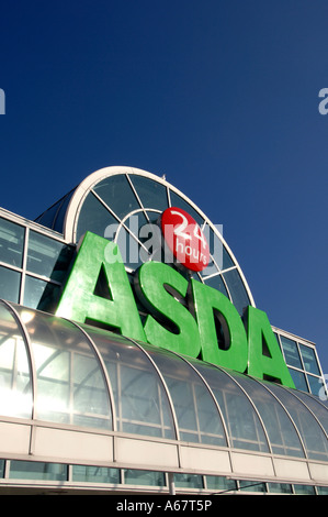 The entrance of a new 24 hour opening ASDA supermarket with glass roof - Stock Photo