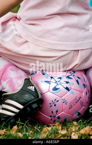 Fashionable pink socks ball and uniform of seven year old girl soccer player. SPA Athletic Field St Paul Minnesota - Stock Photo