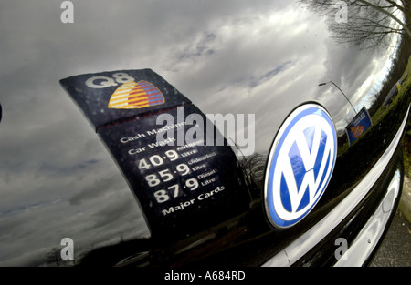 A Q8 petrol station sign reflected in the bonnet of a VW Beetle in a garage at Patcham near Brighton East Sussex - Stock Photo