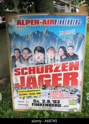 Poster advertising Schurzenjager massive open air jubilee concert in Finkenberg Austria in August 2003 - Stock Photo