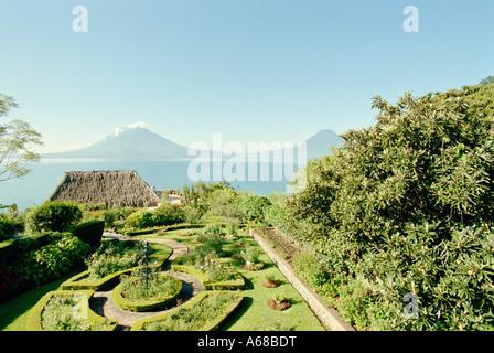 Gardens and lake at Hotel Atitlan, Santiago, Atitlan, Guatemala. - Stock Photo