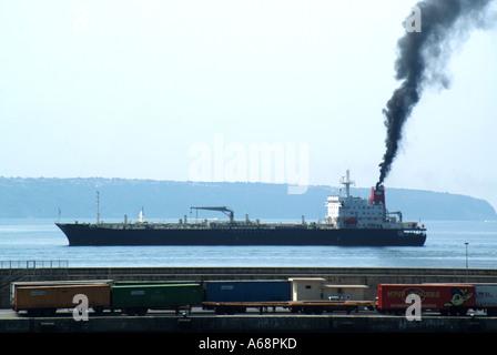 Ship discharging black smoke arriving at Port of Palma Mallorca - Stock Photo
