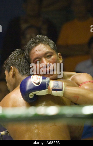 Muay Thai - Bloodied and tired - Stock Photo