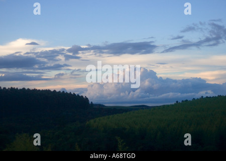 Rolling clouds over forested hills in the Brazillian countryside - Stock Photo