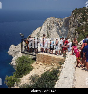 People queue up to see over spectacular sand beach and cove of Shipwreck Bay on west coast of Zakynthos The Greek - Stock Photo