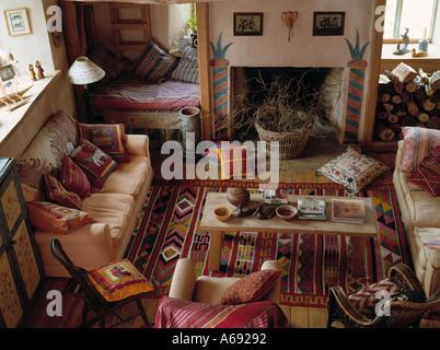 ... Birds-eye view of Kelim rug on floor in front of fireplace in rustic  living
