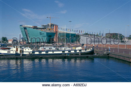 The NEMO science center by architect Renzo Piano in Amsterdam, The Netherlands - Stock Photo
