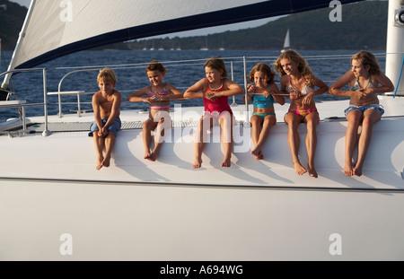 kids on Catamaran sailboat in british virgin islands