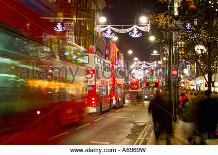 London Buses at night in Oxford Street with Christmas time Stock ...