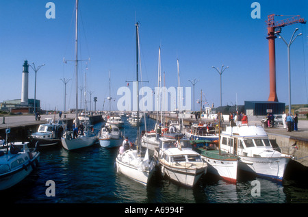 Motor cruisers and yachts in the sea lock at Dunkerque Nord Flandre France - Stock Photo