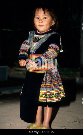 Hmong girl dressed in traditional clothes. Vietnam - Stock Photo