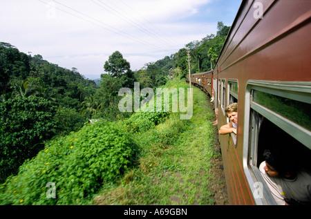 Sri Lanka train passing through landscape near Kandy - Stock Photo