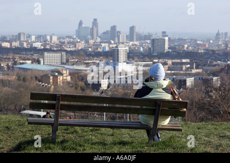 Watching the view from Hampstead Heath's Parliament Hill in London - Stock Photo