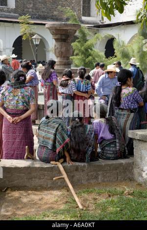Women gather in church courtyard Santiago Atitlan Guatemala - Stock Photo