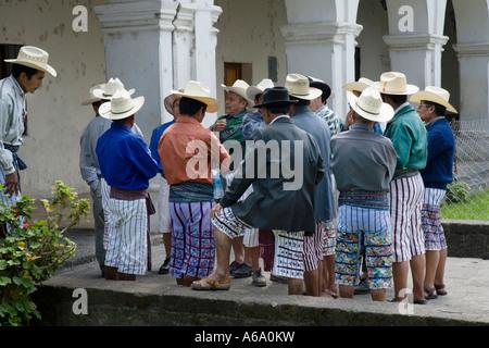 Men gather in church courtyard Santiago Atitlan Guatemala - Stock Photo