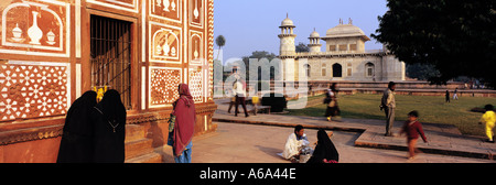 People at leisure and devotions in the grounds of the Itmad ud Daulah the Little Taj Mahal Agra India - Stock Photo