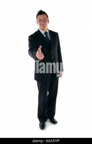 Businessman reaching out to shake your hand - Stock Photo