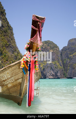 Prows of longtail boats or long tailed boat, with Buddhist garlands, Ko Phi-Phi Don island, Krabi Province, Thailand, - Stock Photo
