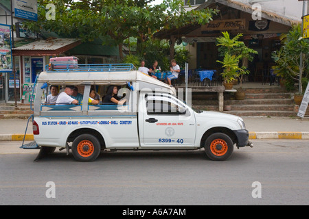 Converted flat van or Songtaews carry local and tourist passengers cheaply around Ao Nang and Krabi Province Thailand - Stock Photo