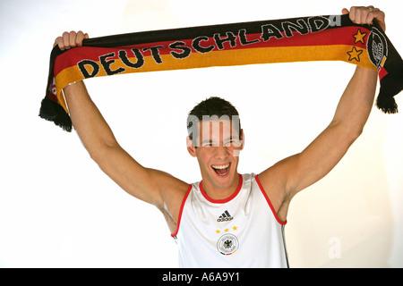 German football fan halfportrait - Stock Photo