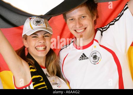 couple as German football fans halfportrait - Stock Photo