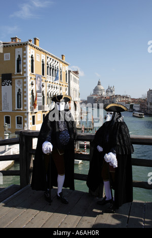 Carnival in Venice, costumes on the Bridge Accademia, UNESCO World Heritage Site,  Italy, Europe.  Photo by Willy - Stock Photo