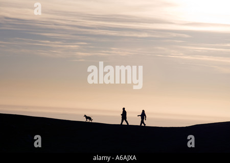 Walkers on top of the Malvern Hills in Worcestershire UK in Winter - Stock Photo