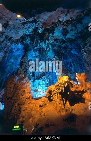 China, Guangxi, Guilin, Guangming Hill, Red Flute Cave,  illuminated hall in cave, stunning limestone formations - Stock Photo