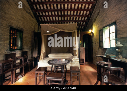 China, Guangdong, Zhongshan County, Cuiheng, Sun Yat Sen's Residence, four-poster bed in bedroom in Portuguese-style - Stock Photo