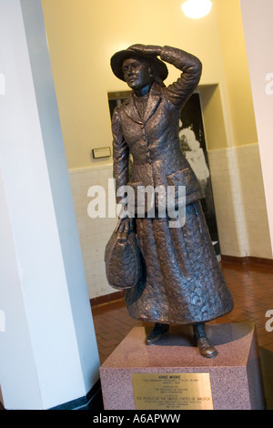 Statue of 15 year old Irish girl, Annie Moore, first immigrant processed at Ellis Island, 1892 NY New York State US USA