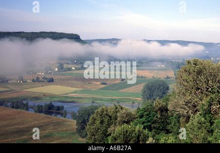 Dordogne Beynac Perigord France broken clouds of mist over farming landscape beside River Dordogne - Stock Photo