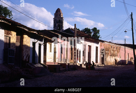 Late afternoon sun lights up the colourful building facades in Trinidad Cuba - Stock Photo