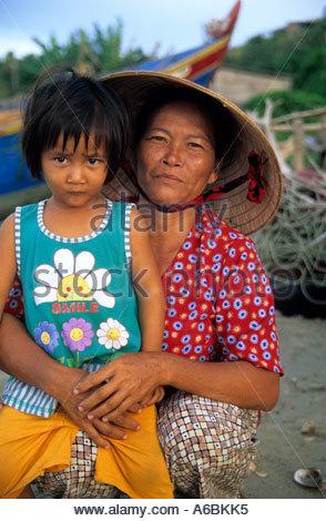 Mother and daughter at Mui Ne fishing village Phan Thiet Vietnam - Stock Photo