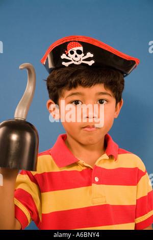 Portrait of Hispanic boy dressed like pirate - Stock Photo