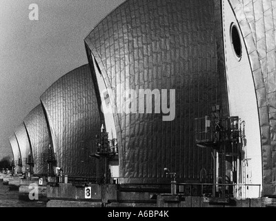 THAMES BARRIER in Woolwich, London, converted to black-and-white, with grain added to the image. - Stock Photo
