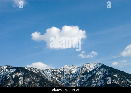 white cloud over a mountain top near Fall Karwendel Bavaria Germany - Stock Photo