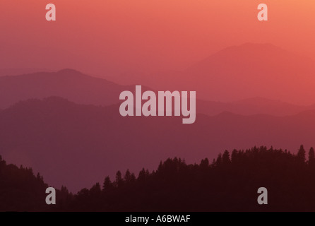 Sunset colors the haze in the valley below Moro Rock Sequoia National Forest Sierra Nevada California USA - Stock Photo