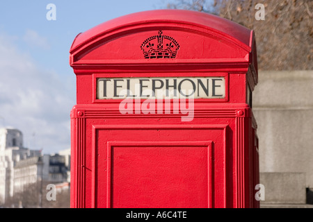 A PHONE BOX LOOKING AT THE LONDON EYE - Stock Photo