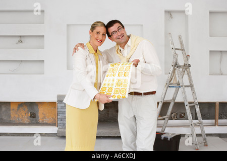 Portrait of Couple with Wallpaper Sample - Stock Photo