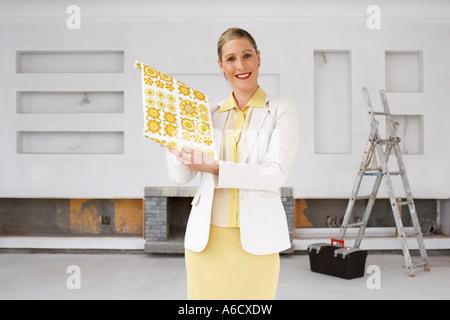 Portrait of Interior Designer with Wallpaper Sample - Stock Photo