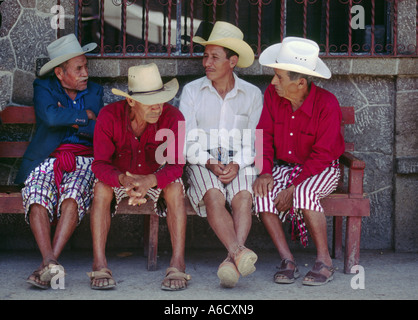 TZUTUJIL MEN in traditional dress with COWBOY HATS SANTIAGO ATITLAN GUATEMALA - Stock Photo