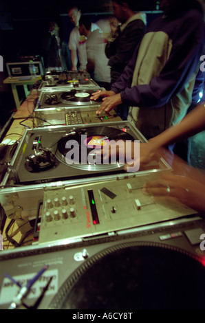 djs hands scratching and playing records playing everything from garage to hip hop scratch scratch hand hands - Stock Photo