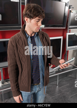 Man Shopping for Television - Stock Photo