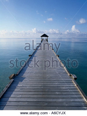 Pier stretching into the ocean, Maldives - Stock Photo