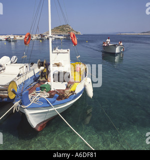 Colourful traditional style little Greek fishing boat moored at quayside in Agios Nikolaos port of Zakynthos The - Stock Photo