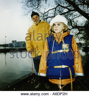 A girl and her grandfather going fishing - Stock Photo