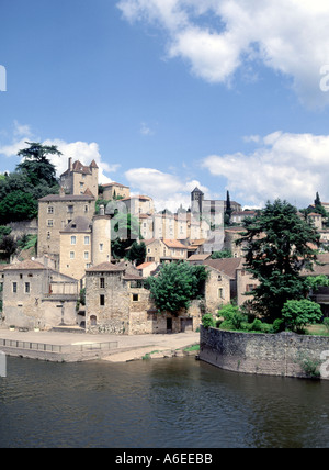 French stone buildings in village on hilly landscape at Puy L Eveque commune in Lot France Europe with the River - Stock Photo