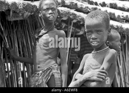 Hungry boys during civil war. Bahr al Gahzal, South Sudan - Stock Photo