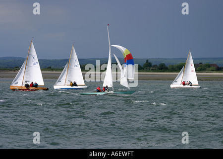 Three X class racing yachts pass another yacht, East Head, Sussex, England - Stock Photo